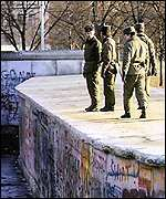 East German soldiers on Berlin Wall