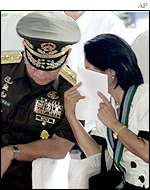 President Gloria Arroyo (right) with Armed Forces Chief General Angelo Reyes