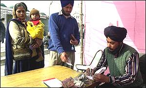 Money being collected in Sikh temple in New Delhi