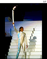 Cathy Freeman holds Olympic torch at Sydney 2000's opening ceremony