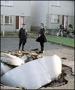Police guard debris from Pan Am bombing in Lockerbie