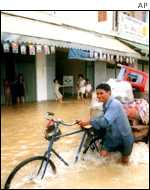 Cyclist in flood AP