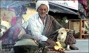 A man and his granddaughter try to keep warm in Bachao