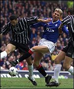 Tore Andre Flo battles with Youssef Rossi