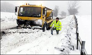 A snow plough gets to work in Scotland