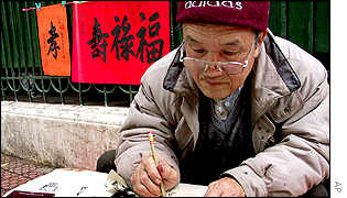 Man writing New Year messages