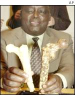 AP Community Museums of Kenya Director Andrew Kiptoon shows replicas of bones of human ancestors