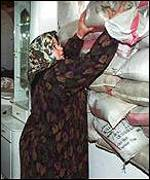 Palestinian woman reinforcing her home