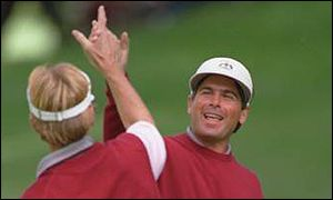 High fives for Fred Couples and Brad Faxon