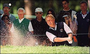 Colin Montgomerie splashes out of a bunker