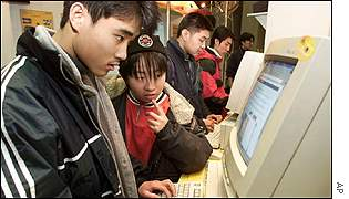 Young people surf at an internet stall