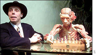 Prof Gunther von Hagens and a preserved human corpse