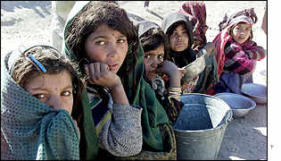 Afghan girls wait in a soup queue