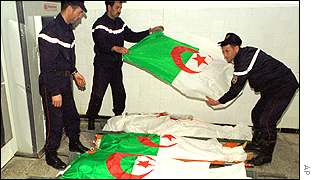 Algerian soldiers covering victims of the weekend massacre
