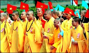 Buddhist minks parade carrying Vietnamese flag