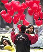 Hawker sells heart-shaped balloons in Delhi