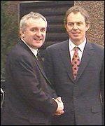 Irish Prime Minister Bertie Ahern and UK Prime Minister Tony Blair shake hands