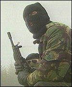 An IRA gunman with assault rifle