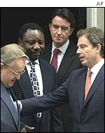 Tony Blair and Peter Mandelson with inspectors Martti Ahtisaari and Cyril Ramaphosa