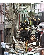 Emergency services inspect the damage caused by the car bomb - 28 people were killed