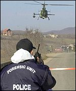 A UN helicopter evacuates victims from the scene