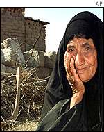 Iraqi woman reacts to destruction of her house in US bombing