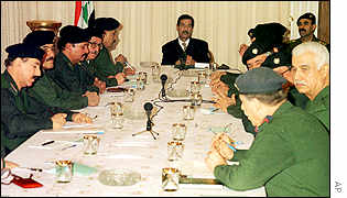 Saddam Hussein chairs a meeting of top officials