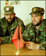 Shefket Musliu, right, commander of the ethnic Albanian rebels called the UCPMB, with colleague