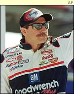 Dale Earnhardt waves to fans at Daytona