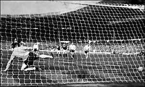 Jim Baxter scores against England in 1963
