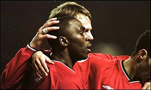 Andy Cole is congratulated on scoring by Teddy Sheringham