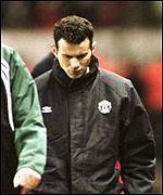 Ryan Giggs walks off dejected after injury forced him out