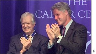 Former Presidents Jimmy Carter, left, and Bill Clinton