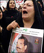 A woman chants anti-Western slogans in Baghdad
