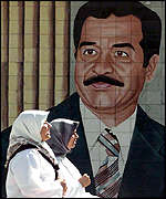 Saddam Hussein stares out from a poster in the Iraqi capital