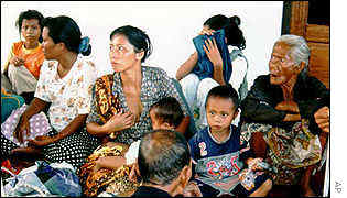 Migrant Madurese families take refuge in a police station near Sampit