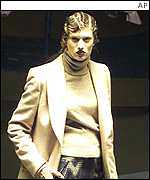 A model displays a chic jacket and polo neck