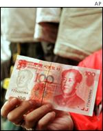 100 Yuan note featuring a portrait of Chairman Mao Tse-tung,