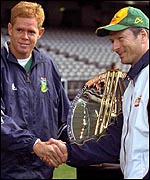 South African skipper Shaun Pollock and Australia's Steve Waugh