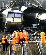 Rail officials inspect the crash site