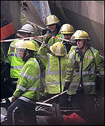 Fire crews cut people free from the wreckage