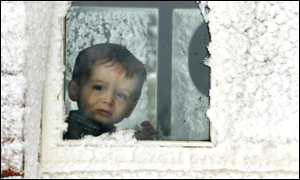 Daniel Faith aged two looks out from his snowbound home in Broughshane, Northern Ireland