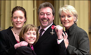 Jeremy Beadle with (l-r) daughters Cassie, 15, Bonnie, 13, and wife Sue