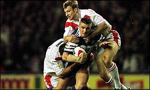Tim Jonkers of St Helens tackles Wigan's Terry Newton