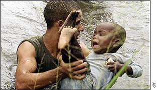 A soldier rescues a child in the Caia district