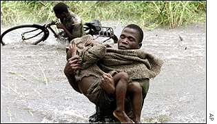 A soldier rescues a child in Caia district
