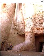 Bamiyan Buddha statue with man for scale