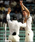 Langer and McGrath celebrate a wicket