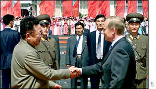 North Korean leader Kim Jong-il welcomes Mr Putin to Pyongyang