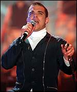 Pop singer Robbie Williams on stage at the 2001 Brit Awards
